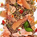 Close Up Poached Salmon, Grapefruit, Grains, and Chile